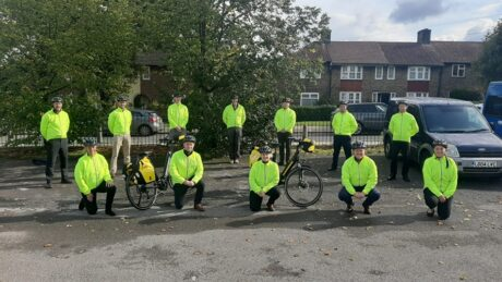 A group of a paramedics in hi vis coats and bicycles