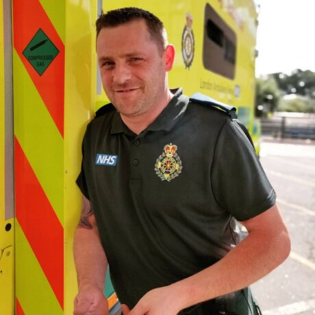 Paddy stood next to an ambulance in his Service uniform