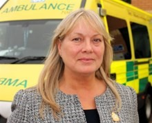 Kim Nurse photographed in front of an ambulance