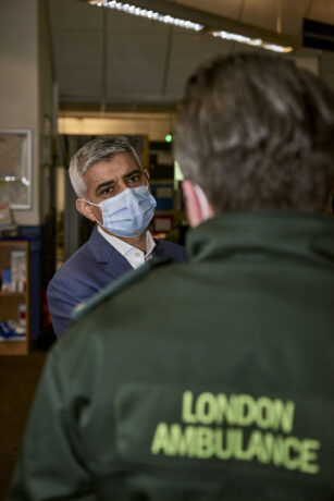 Mayor of London speaking to a LAS staff member who is shown from behind with London Ambulance uniform