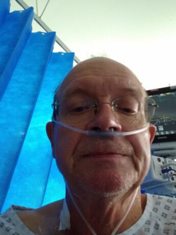 Brian in hospital with a nasal cannula