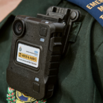 A close up showing Gary's body worn camera attached to his uniform