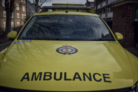The bonnet of an ambulance car with the LAS logo and the word ambulance