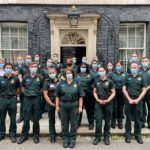 A group of medics in LAS uniform stood outside the door to 10 Downing Street