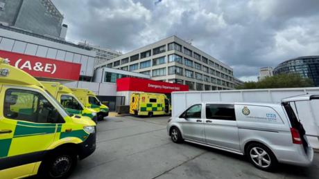 A tea Truck parked at a hospital bay alongside ambulances