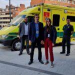 Nicolas, Alaia with medics (L) John, Vijay, Junaid and Kirsty stood in front of an ambulance