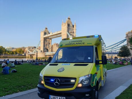 Ambulance in front of Tower Bridge of sunny day