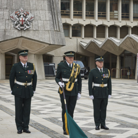 Our Ceremonial Unit in their formal dress at the Guildhall event with a flag lowered