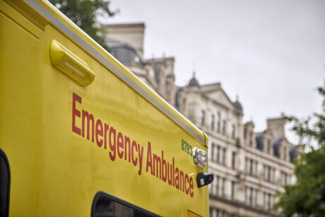 An image showing the side of an ambulance with the words Emergency ambulance visible