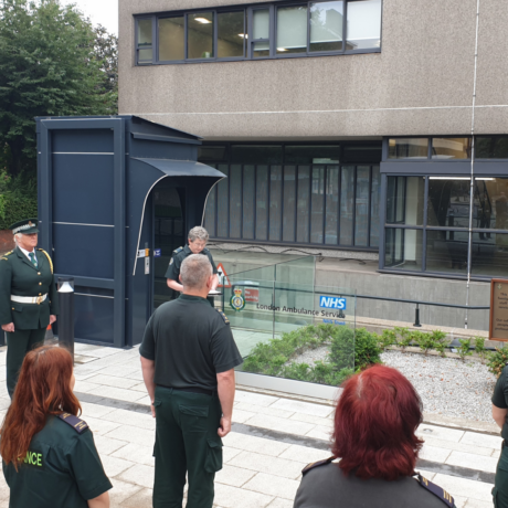 A small group of LAS staff observing a silence in our headquarters memorial garden